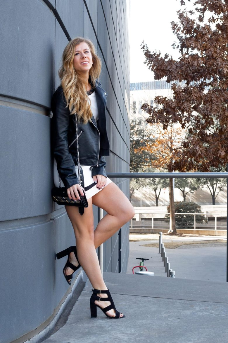 Basics to buy from the Nordstrom Anniversary Sale, featured by top US fashion blog, Running in Heels: image of a woman wearing a faux leather moto jacket