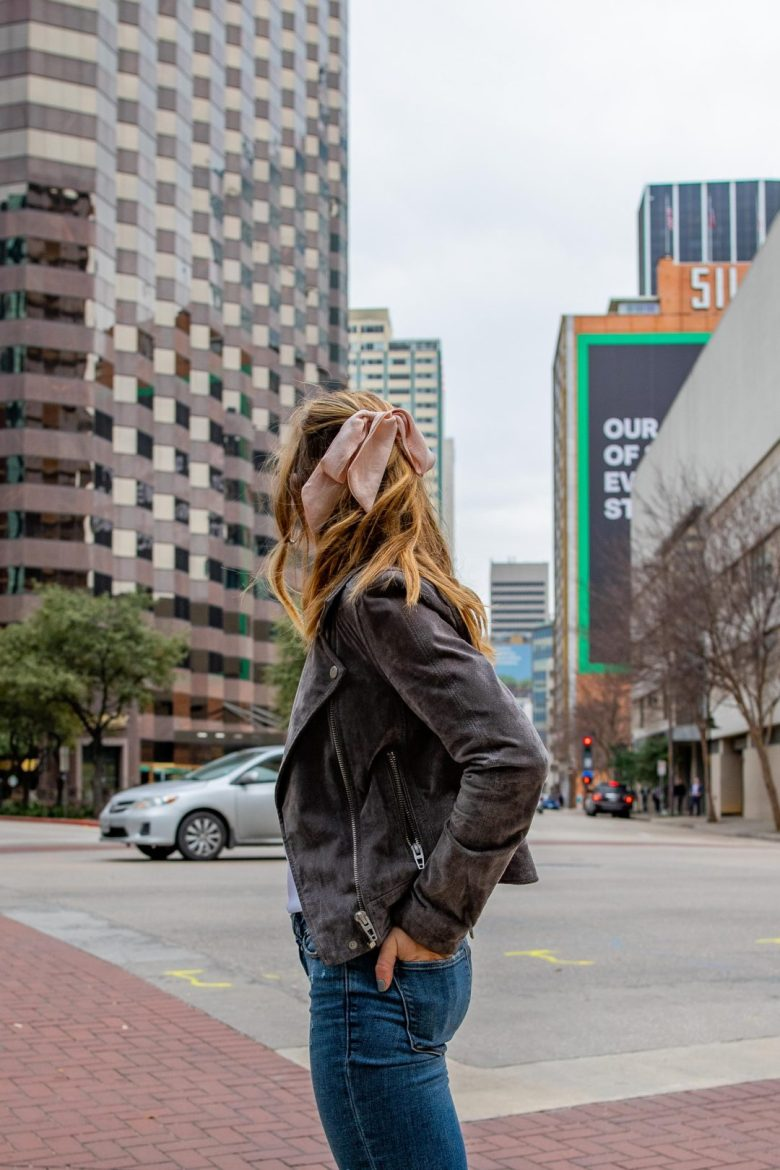 Basics to buy from the Nordstrom Anniversary Sale, featured by top US fashion blog, Running in Heels: image of a woman wearing a suede moto jacket by Blank NYC
