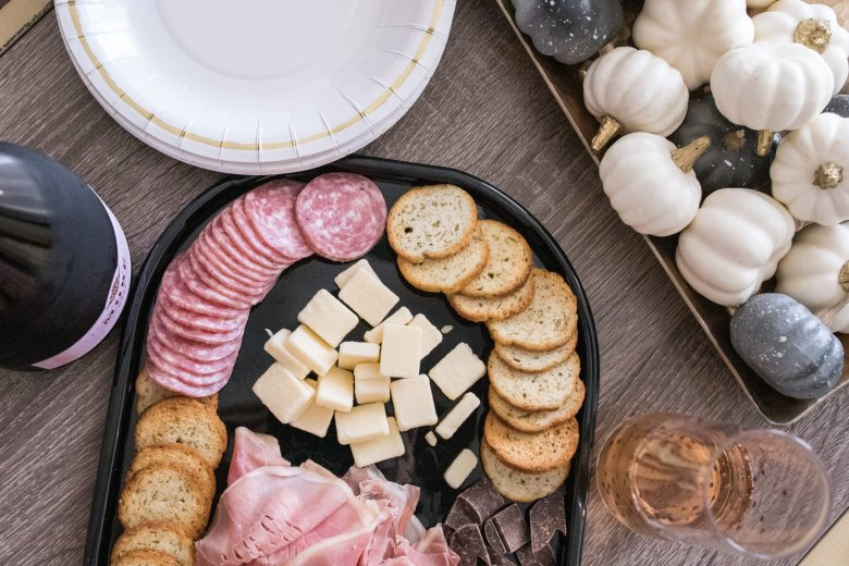 Hosting Tips for the Best Friends Holiday Party, try a Hillshire Farm snacking platter and rosé cava sparkling wine, feature by top US fashion and lifestyle blogger Running in Heels