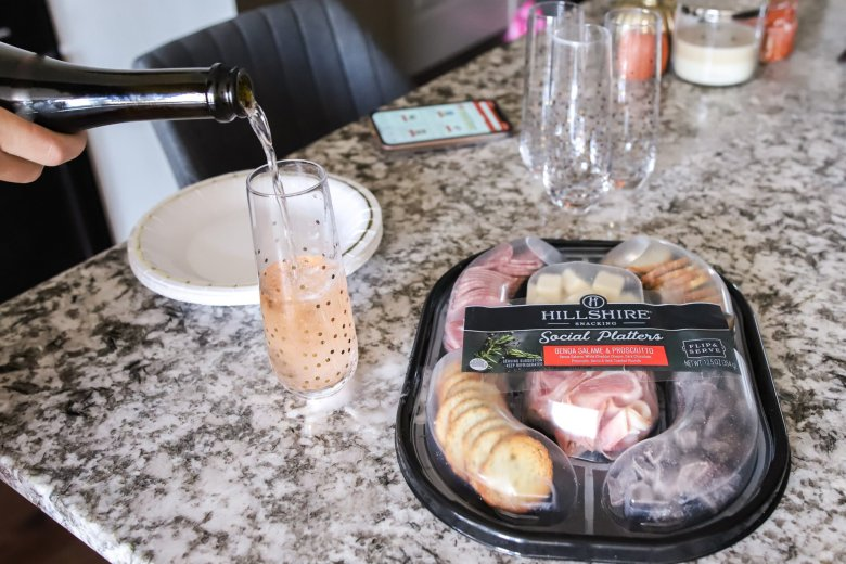 Hosting Tips for the Best Friends Holiday Party, try a Hillshire Farm snacking platter with Cava rosé sparkling wine feature by top US fashion and lifestyle blogger Running in Heels