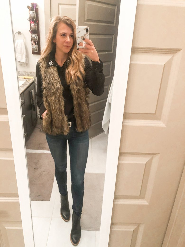 Black chiffon button up, H&M fur vest, and DL 1961 jeans with black leather booties by Top US fashion and lifestyle blogger Running in Heels