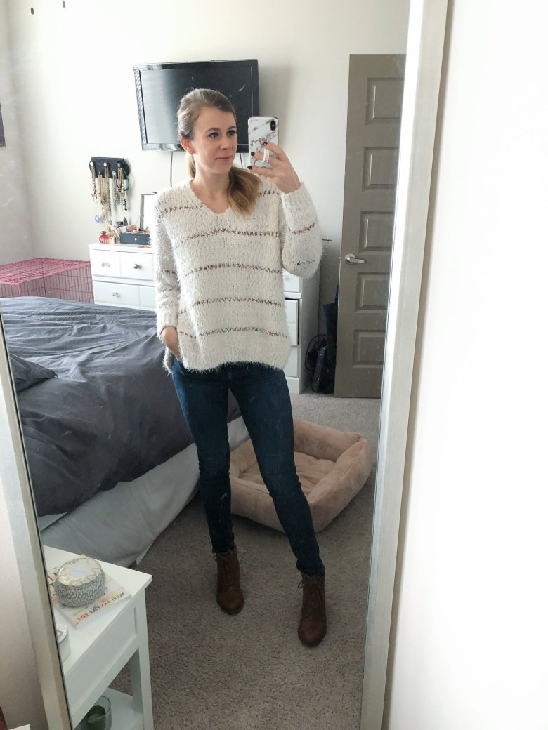 Altar'd State white sweater, jeans, and lace-up booties featured by Top US fashion and lifestyle blogger, Running in Heels.