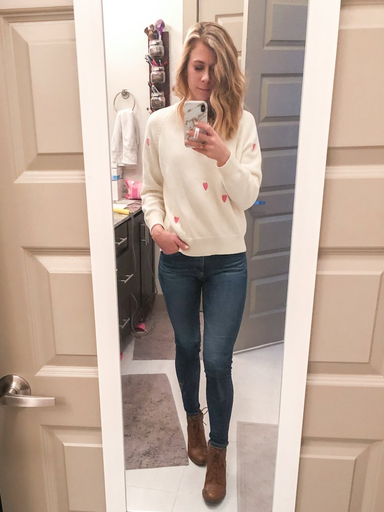 Cream heart-sweater paired with J-Brand jeans and DSW lace up booties.