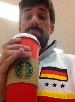 Germany Jacket and Red Starbucks Cup