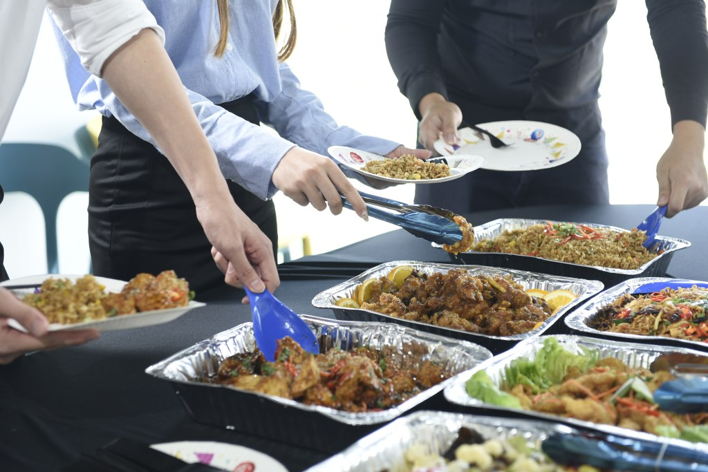 runningmen catering buffet photo with people taking food