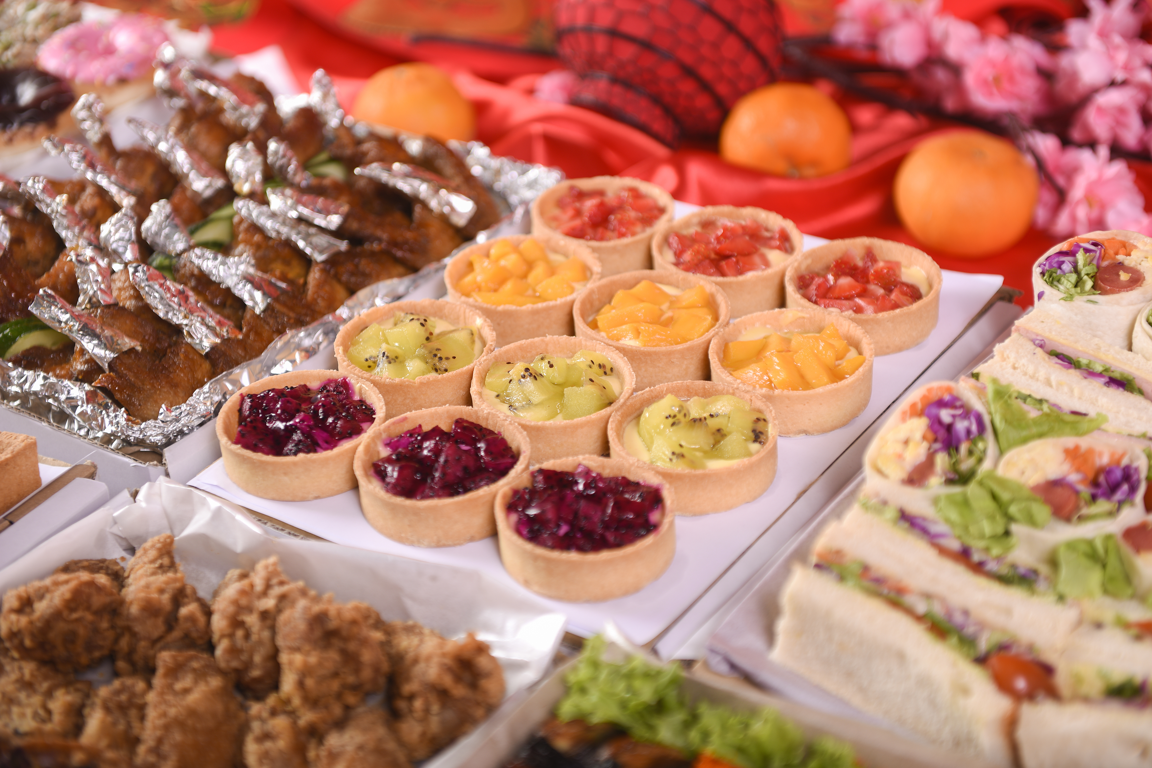 runningmen catering foodie box round square fruit tarts with grapes, kiwi, mango and watermelon