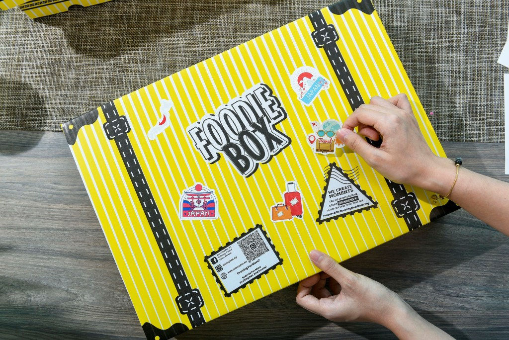 runningmen catering foodie box travel theme with luggage stickers showcase
