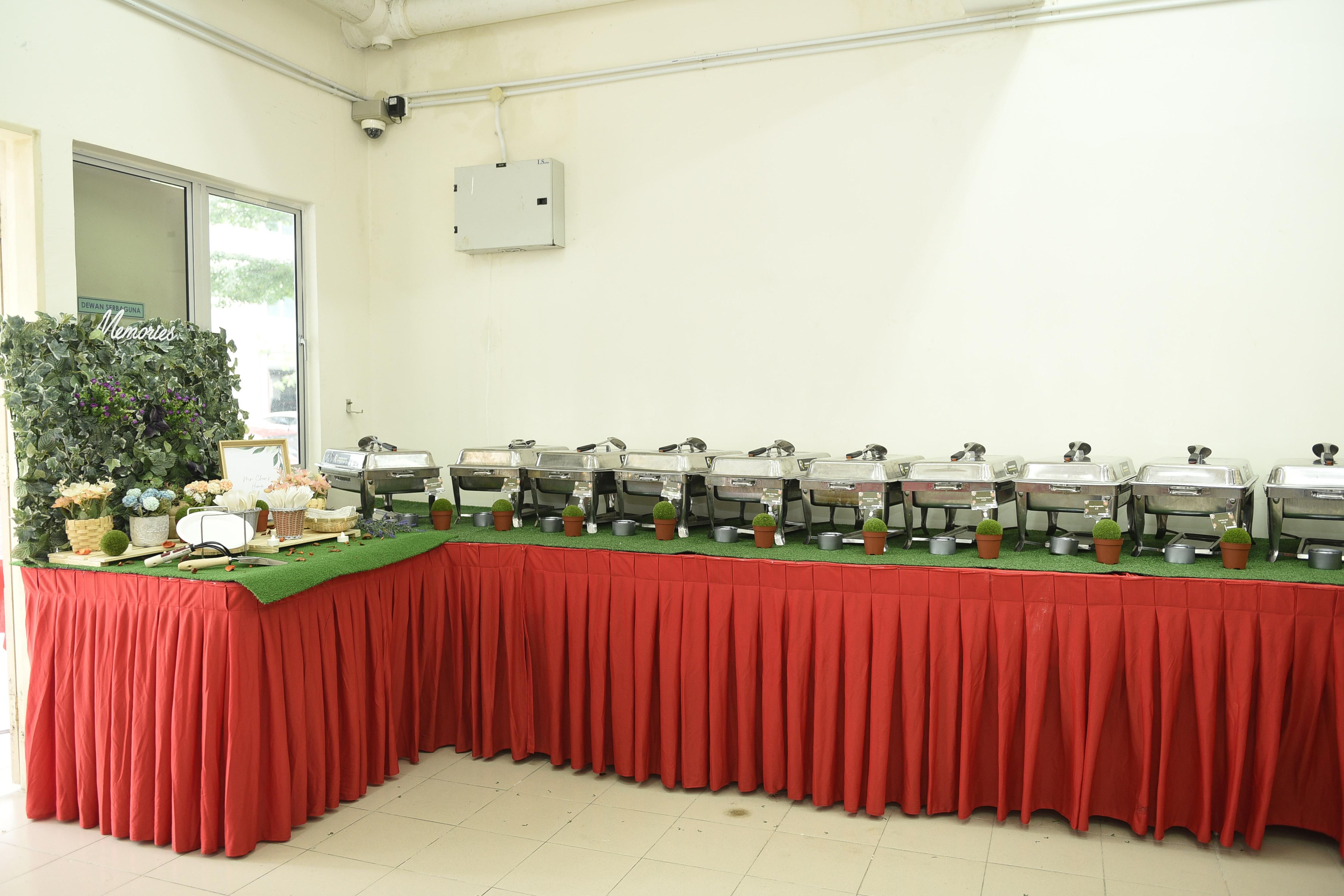 runningmen catering buffet line setup with grass base