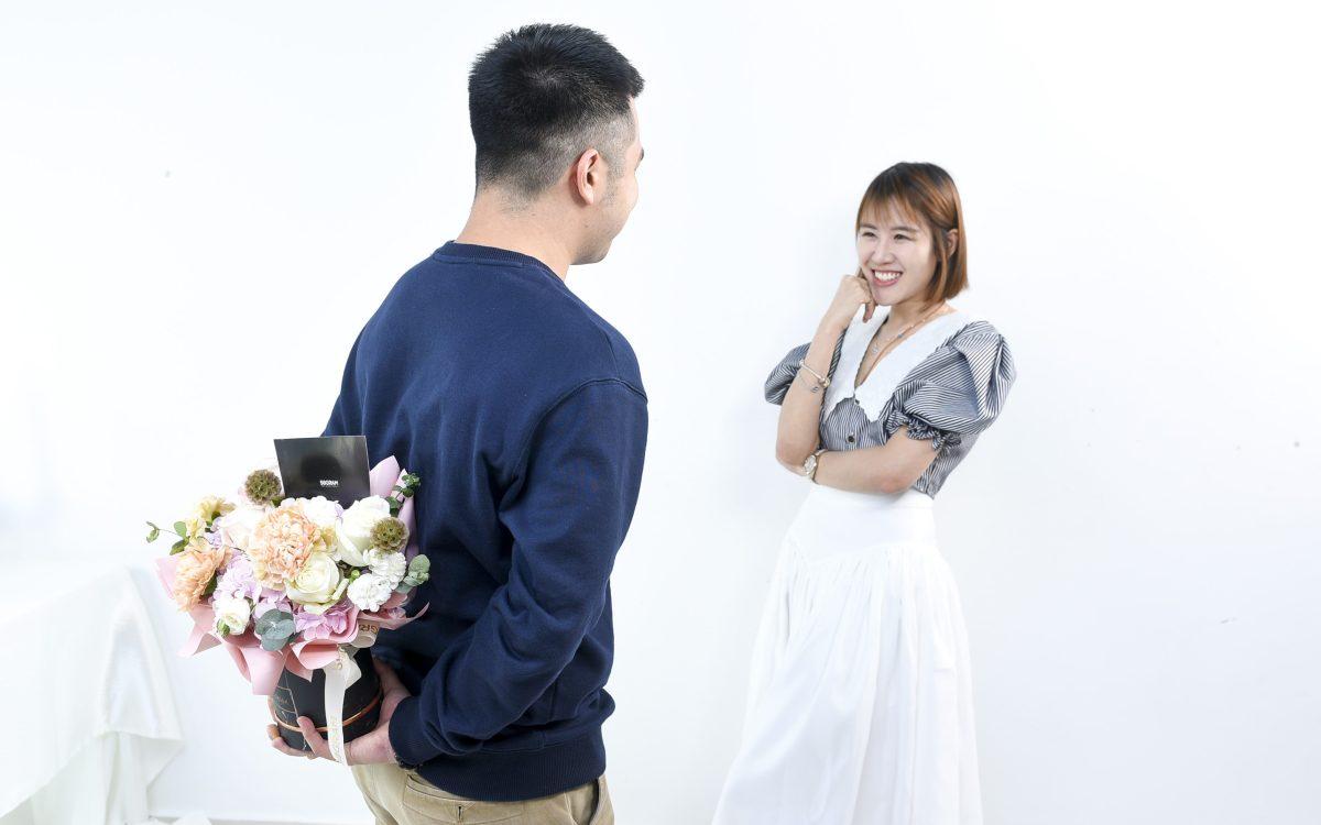 man passing flower gift to girl secretly