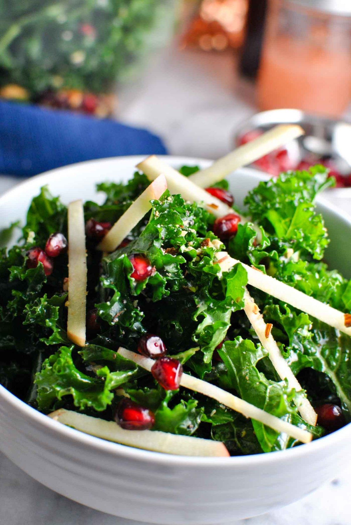 a super easy AND pretty kale apple almond salad! it's perfect for the holidays, i could totally see it as a potluck item or on the dinner table as a healthy side!   thepikeplacekitchen.com