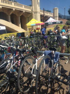 Esprit de She bikes racked while picking up packets