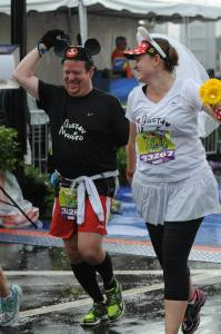 Jen and her husband finishing a runDisney event as newlyweds.