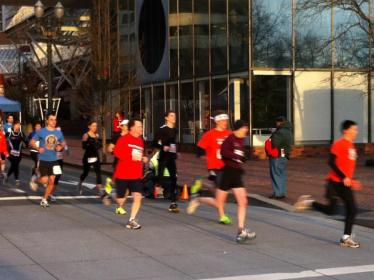 Several runners lead the way at the start of the 2012 5K race. - Photo by Beaver Cutter
