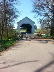 The course runs under the covered bridge between mile 3 & 4. - Photo via Corvallis Half Marathon