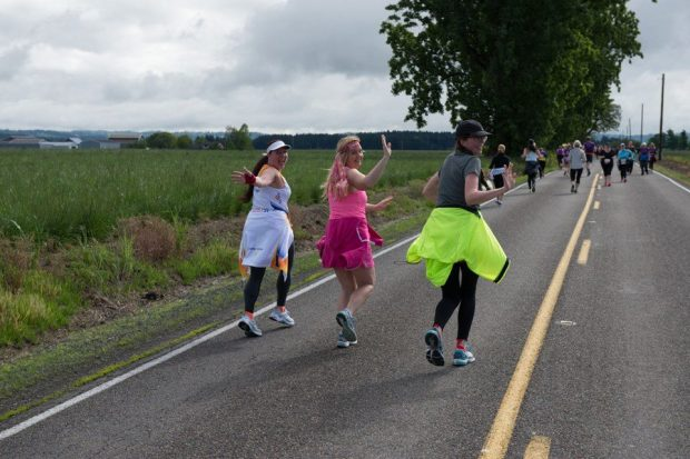 Robin, Maryalicia and Kim at mile 7 of the Hippie Chick Half Marathon
