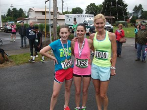 The top three women finishers in the 5k.