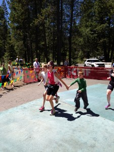 My favorite moment from the race: my two children running me in.  Photo credit: Sue Fillman