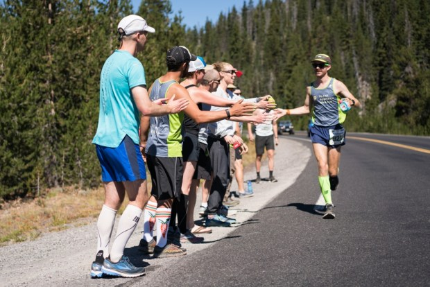 team-cheering-on-andrew-during-what-the-hell-hill-cascades-lake-relay-1030x687