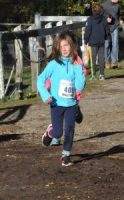 Molly Skolnick on her way to the 6 & under finish line. (photo by Alan Wegener)