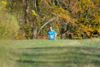 Nick Roosa cresting the last hill about 1/2 mile before finishing first in the seventh annual Run The Farm 5 miler.