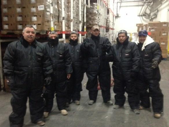Crew in freezer suits