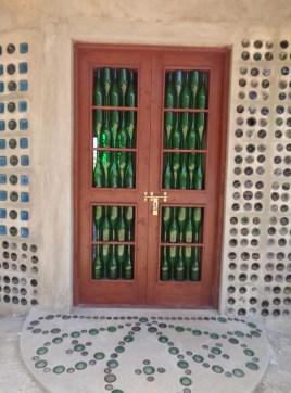Recycled wine bottle door by Andrew McNaughton at EcoWorld, Watamu