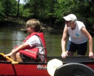 Katherine and grandson canoeing