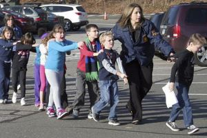 connecticut-state-police-lead-children-from-the-sandy-hook-elementary-school-after-shooting-dec-14-that-left-27-dead