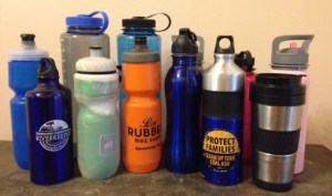 Water bottles come in all shapes and sizes. The stainless steel travel coffee tumbler (front row, far right) was part of an anniversary gift from my husband in 1996. Most coffee shops offer a discount if they fill your cup instead of theirs.