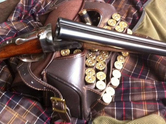 Shotgun, Cartridges and a Cartridge Bag