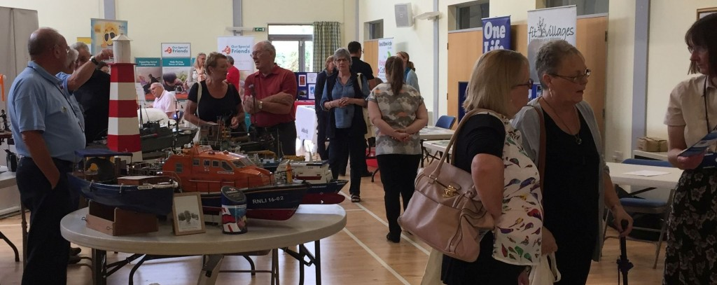 Photo of attendees of previous Lavenham talking to organisations on their stands