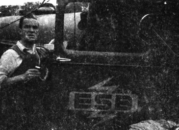A rural worker, pictured beside the ESB's special Rural Electrification Scheme logo