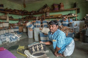 Left: In Mekalmardi village, in an effort to enhance his income, Dastagir Jamdar has been combining jute, leather and wool to improvise bags and other items. Right: Dinesh Seth, shop manager, checks the quality of a blanket. The average price of such blankets in the shops ranges between Rs. 800 and Rs. 1,500, and smaller rugs cost Rs. 400 to Rs. 600. But the demand for Deccani woollens has been steadily falling