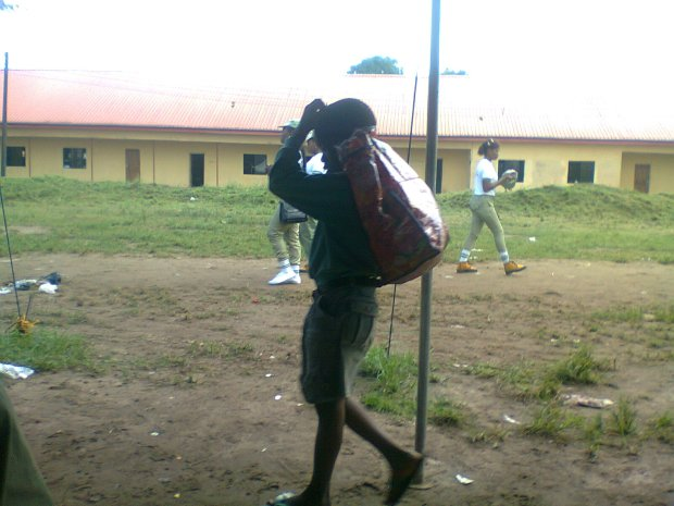 Child-Scavenger:  He picks up leftover left by youth corp members in Akwa Ibom camp.