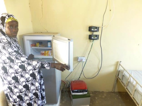 Senior Health Official of Gashala Manud Primary Health Center with the Solar-powered refrigerator provided by UNDP