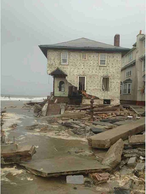 Damage_from_Hurricane_Sandy_to_house_in_Brooklyn,_NY.jpeg