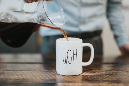 """Don't be afraid to fail. Image of Coffee being poured into a cup that has the word """"ugh"""" printed on it."""