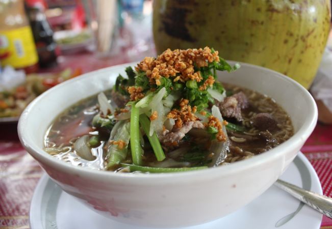 Tasty beef noodle soup somewhere opposite Ta Prohm.