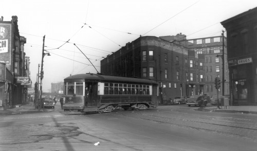 A streetcar travels up Harrison Street just to the west of the Rush University Medical Center campus in 1948.