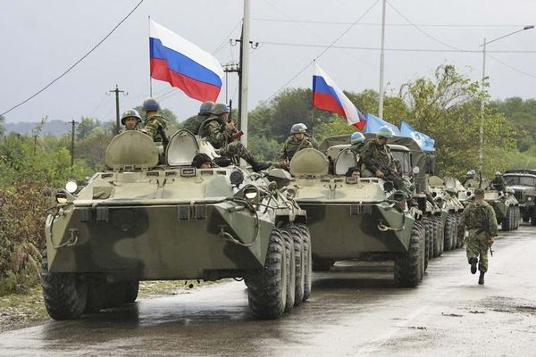 A column of Russian troops prepares to leave the checkpoint at a bridge over the Inguri River in Western Georgia