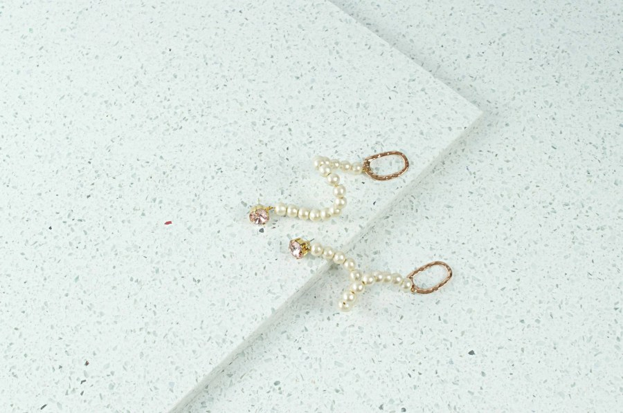 cream pearl swan earrings