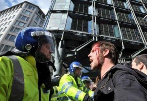 st15-bloody-protester-v-cop