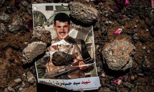 Снимка върху гроб в Машхад на афганистанец, сражавал се в про-иранска бригада в Сирия. Photograph: Mujtaba Jalali for the Guardian