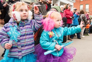 Bristol Alexander, 3 of Farmington, left, and her cousin Charloette Emery, 2 of Wayne, wave to Santa as he makes his way down Main Street Saturday morning during the annual Chester Greenwood Day Parade in Farmington.