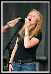Kristi singing during the festival