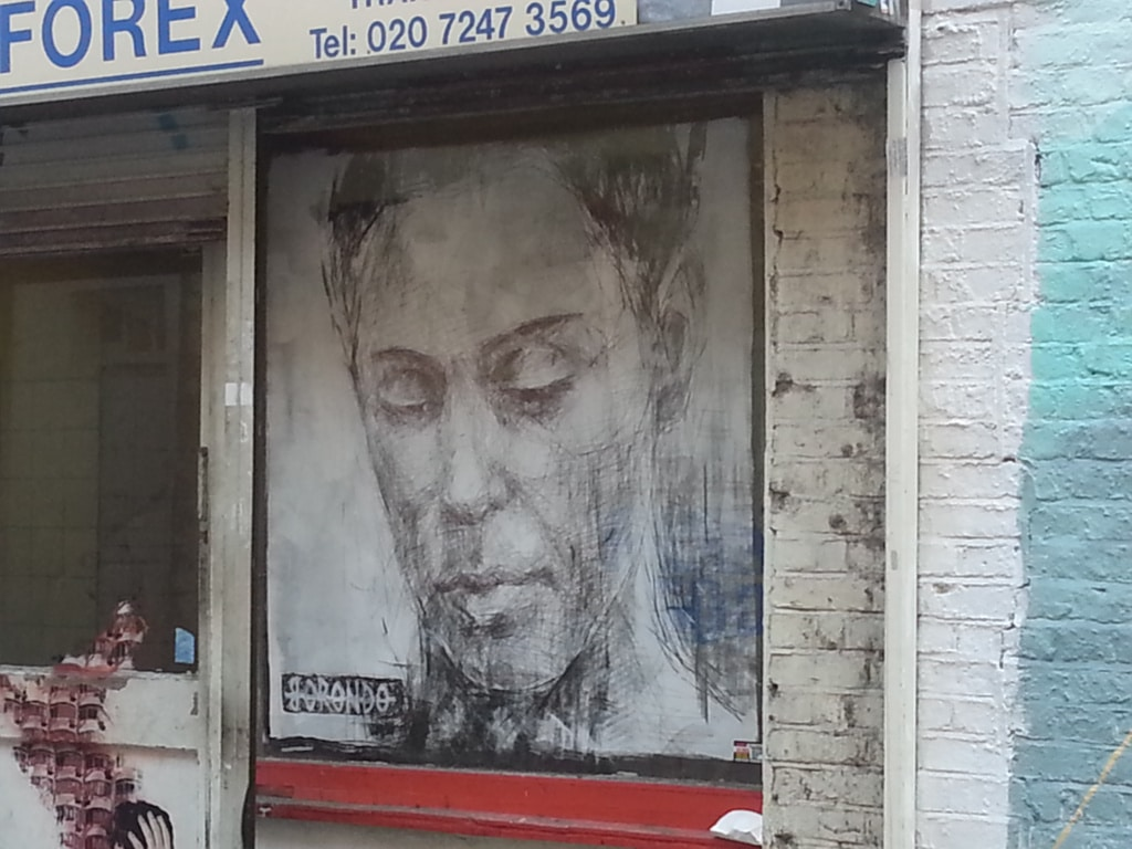 Scratched out art in dirty window