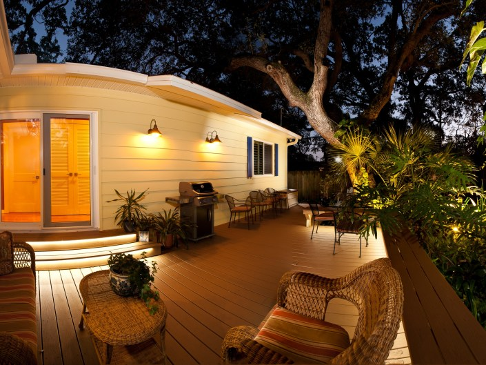 Architectural Photo of an outdoor deck at night.