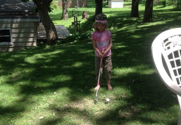 Maddie golfing