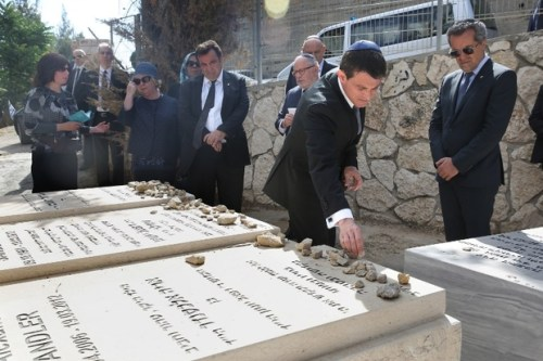French Prime Minister Manuel Valls visits the graves of Jonathan, Arie and Gabriel Sandler, killed in a 2012 attack on a Jewish school in Toulouse