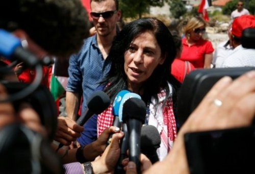 Prominent Palestinian lawmaker Khalida Jarrar speaks to reporters in her hometown, the West Bank city of Ramallah, following her release from an Israeli jail on June 3, 2016